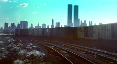 WTC 225 (stevensiegel260) Tags: worldtradecenter twintowers newyorkskyline manmhattanskyline newjersey train railroad boxcars 1980s 1970s