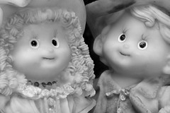 Our hearts a thumpin' (Allan Saw) Tags: bw white black dolls figurines