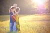 Evening Songs (Proleshi) Tags: music woman girl field 50mm golden rachel model bokeh guitar song ambientlight guitarra naturallight hour maiden eveninglight bluedress enchanting d300s 50mm14afs sunlightthroughhair proleshi jamaljosephs