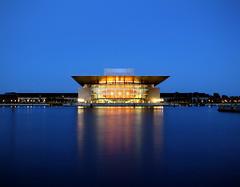 Copenhagen Opera House (Dimitry B) Tags: longexposure blue sea sky house reflection water glass night copenhagen river denmark gold opera quay clear stillness maersk 5photosaday