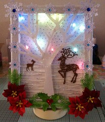 Christmas canvas with lights. (CraftyBev) Tags: christmas canvas lights deer poinsettia snowflakes diecuts sparkle holly
