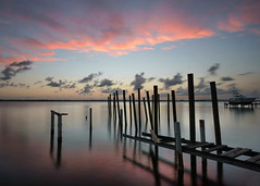 A ghost of its former self. (Jill Bazeley) Tags: pier pilings ruins derelict abandoned dock indian river lagoon intracoastal waterway merritt island brevard county space coast florida sunset reflections timelapse smooth app sony a6300 rokinon 12mm alpha planks gangway