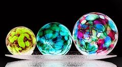 Three Orbs (Karen_Chappell) Tags: orb sphere circle round ball glass dark black colourful negative stilllife three 3 trio blue pink yellow green