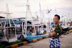 I'd be that happy if I was a fisherman too (cteteris) Tags: morning sea portrait man flores smile port indonesia boats dawn fisherman harbour 50mm14 sarong labuanbajo nusatenggara nikond700 floreasea
