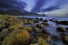 Kogel Bay at Dusk (Michael Morris | The Trekking Tripod) Tags: sunset sea seascape landscape bay rocks dusk bluehour els kogelbaai gordonsbay westerncape rooi kogel koeel michaelmorris nikond7000