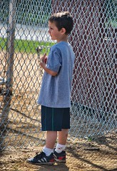 Longing to Play (podolux) Tags: fence newjersey kid nikon child nj jersey nikkor 2009 southjersey unaware unsuspecting moorestown burlingtoncounty outsidelookingin 18200vr d80 april2009