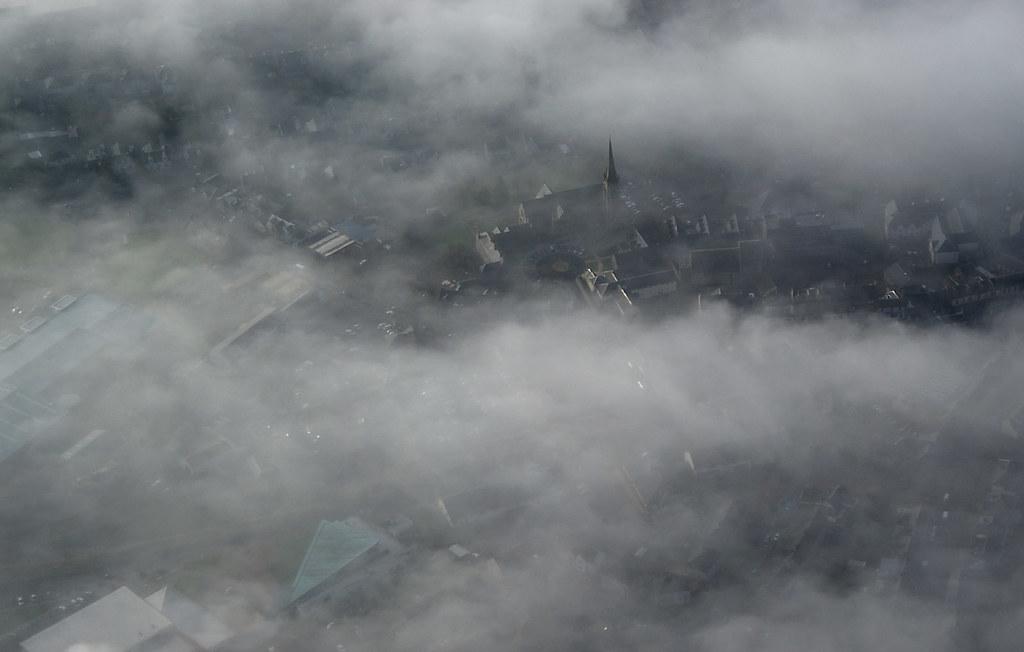 Lanark church steeple sticks through the fog