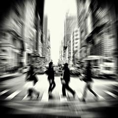 midtown breeze (fotobananas) Tags: city nyc urban blackandwhite newyork blur crossing traffic zoom walk manhattan streetphotography 5thavenue midtown zebra abbeyroad fifthavenue breeze s95 fotobananas