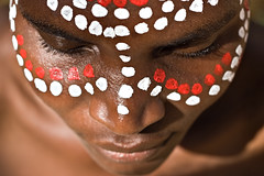 Tribal face (Mone Monkey) Tags: africa flowers red portrait people woman white black girl beautiful face up look lines female person design eyes hands paint mask emotion artistic native top african background character painted traditional fingers profile young culture sunny tribal lips symmetry human attractive africanamerican features botswana dots ethnic wrinkles individual archaic