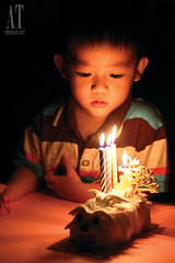 Happy Birthday~ (Alphone Tea) Tags: life light boy shadow red portrait people favorite white black art home beautiful childhood cake kids composition contrast pose print children photography golden photo amazing model singapore asia pretty candle bright image little sweet modeling brother great models chinese perspective adorable indoor romance happybirthday lovely 50 2012 wishing handhold 60d
