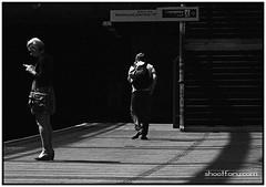 Strangers in the night (shootforu.com) Tags: windows light woman london station dark tube mobilephone texting ringexcellence atmospheremoodmale
