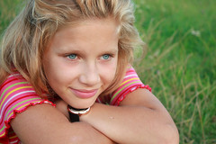Julia (Mary Oceans) Tags: pink summer portrait people color green girl beautiful beauty smile grass childhood closeup youth contrast children happy daylight kid spring nice model eyes child close eyelashes julia bokeh blueeyes joy young headshot glad curly blond tender fairhair chidhood