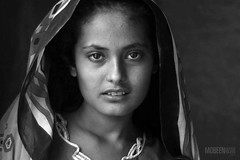 A Sindhi girl in Thatta- EXPLORED! (Mobeen_Ansari (in Seattle, LA, TX and DC July-Augu) Tags: blackandwhite white black portraits flood victim explore portraiture karachi bnw sindhi flickrexplore thatta explored nikond90