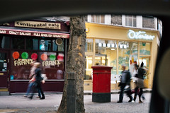 bimbling around the cafe (emuseries) Tags: street people tree london film car cafe movement blurred shops olympusom10 bimble