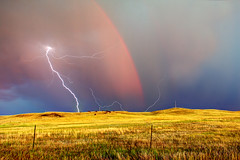 Lightning out of a Rainbow (Kevin Aker Photography) Tags: storm weather southdakota rainbow thunderstorm lightning prairie rapidcity severe severeweather severethunderstorm southdakotaprairie southdakotathunderstorm kevinaker kevinakerphotography severelightning awesomeweatherphotography awesomelightningphotography