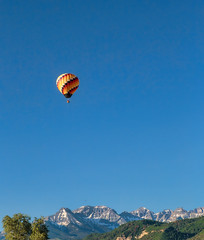 Best view in town. (Scosanf) Tags: colorado outdoor sky baloon hotairbaloon colorful mountains rockymountains sanjuanmountains sunlight negativespace composition blue red yellow orange travel trip vacation summer canon eos ef2470mmf28lusm 6d topazlabs
