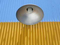light (kenjet) Tags: light metal yellow lamp high panel panels corrugated corrugatedmetal shine bulb