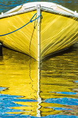 The Ripple Effect (Lisa Bell Jamison) Tags: boat yellow ripples water glaciernationalpark montana twomedicine