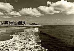 The Beach in September (Robert S. Photography) Tags: beach scenery waves sky clouds sand wet buildingsindistance ferriswheel coneyisland sepia monochrome serenity solitude latesummer nikon coolpix l340 iso80 brooklyn newyork september 2016