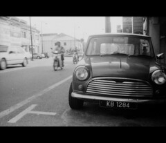 Mini's domain. (khai_nomore) Tags: street bw film 35mm streetphotography hc110 mini negative scanned olympustrip35 kedah rm standdevelopment kulim 2400dpi era100 homedevelopment canonscan8400f autaut 212hours 1100dilution 6minutefix