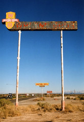 Whiting Bros. (Nick Leonard) Tags: old morning blue red arizona sky signs classic beautiful sign yellow 35mm canon vintage outside outdoors amazing route66 desert diesel nick motel 200asa roadtrip wb scan retro company american 35mmfilm signage yucca timeless canont70 colorfilm epson4490 canonfilmcamera whitingbros walgreensbrandfilm whitingbrothers nickleonard walgreens200