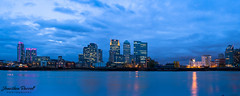 Canary Wharf - Blue Tones (Jonathan.Russell) Tags: camera city blue england panorama cloud black colour detail reflection building london glass beautiful metal architecture clouds composition canon buildings reflections river landscape photography amazing interesting exposure flickr cityscape colours russell exterior bright dusk jonathan earth air awesome capital greenwich scenic dramatic landmark panoramic diamond diagonal business 55mm docklands british geography canary 1855mm scape powerful iconic riverthames depth hsbc dlr channel backwash barclays cityoflondon lightroom multiculturalism reflecion borris 40d jonathanrussell flickraward promoteu jonooter