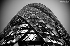 The Gherkin (Jonathan.Russell) Tags: city blackandwhite white black building london architecture night canon flickr foto symmetry gherkin vignette thegherkin cityoflondon togs tfl 40d jonathanrussell promoteu jonooter
