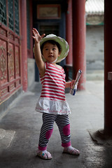 Daughter in the Summer palace (Eason Q) Tags: people casualclothing luck horizontal outdoors 34years sideview headandshoulders looking holding china day beijing,blowing oneperson child dandelion colorimage onegirlonly photography wishing adolescence focusonforeground childrenonlygettychinaq2