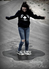 And for once, she felt free (Brittany-Anne) Tags: portrait water girl rain puddle jump action converse splash nikond5000