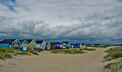 beach huts at mudeford spit (dandraw) Tags: sky beach clouds sand nikon huts beachhuts stormclouds mudefordspit d5100