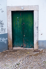 FaroDoor2043 (woodsongsphoto) Tags: sightseeing faro portugal portugese february 2016 travel travelling traveling explore exploring adventure adventuring city town urban sight sights view landscape see tour arch architecture build buildings street streets streetart art graffiti tag tagging tags door green greendoor moss derelict rundown cobblestone cobblestones doorway doorways