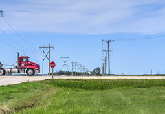 a prairie moment (Keith.CA) Tags: prairie field farm gravelroad highway semi semitrailer powerlines telephonelines bluesky grassland semitruck cab bigrig semitrailertruck stopsign stop