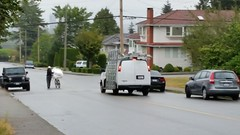 Man with a mattress on a bicycle walks facing traffic (D70) Tags: 239366 no sidewalk for this moving traffic hazard burnaby street bc canada man with mattress bicycle walks facing