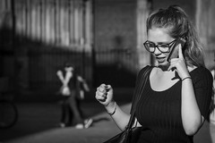 Joyful and connected... (Periades) Tags: bw blackandwhite blackwhite candid connected fille femme girl glasses human lunettes noiretblanc nb photoderue rue streetphotography street streethuman smile sourire woman