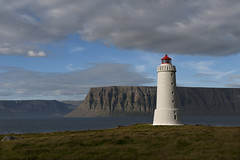 The lighthouse (the bbp) Tags: islanda iceland island westfjords fjords mare sea oceano ocean faro lighthouse natura nature roccia rock nuvole clouds cielo sky erba grass prato field thebbp