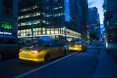 NYC Blue and Yellow (theindependentwolf) Tags: nyc manhattan taxi cab yellow blue skyscrapers night evening sky lights traffic rushhour road street windows redlight