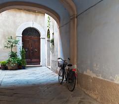 """"""" Wandering around in Pienza """" (pigianca) Tags: italy tuscany pienza streetphoto urbanphoto bike leicaq"""