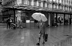 Fashion Capital (bingley0522) Tags: bessar2a canon35mmf20ltm tmax400 hc110h epsonv500scanner milan fashionista rain umbrellas