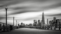 Boardwalk into the city (Eduard Moldoveanu Photography) Tags: city liberty nyc park pier usa worldtradecenter american architecture art attraction bw bench black blackwhite blackandwhite building business center cityscape cloud color district downtown financial fine fineart historic hoboken hudson jersey landmark light longexposure manhattan metropolitan midtown movingclouds new office popular river scenery sky skyline skyscraper state states station street twilight urban view white world york