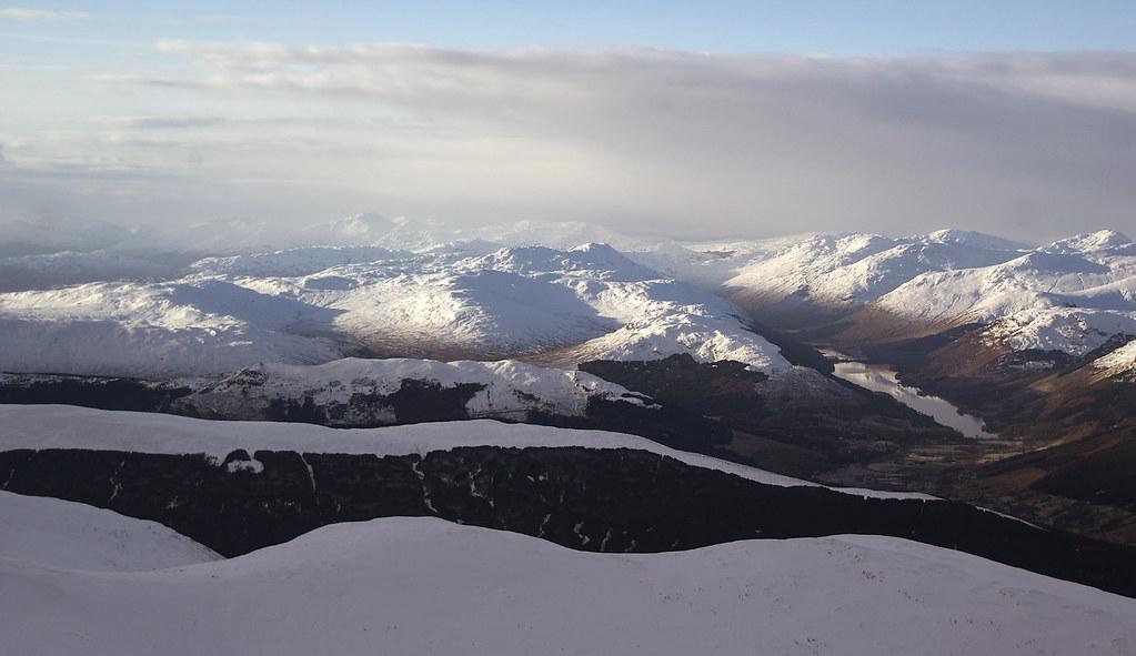 Loch Voil and the distant Arrochar Alps from above Ben Vorlich