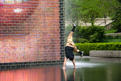 Flips and Giggles (drew*in*chicago) Tags: friends chicago water fountain umbrella couple cityscape play magic tourist millenniumpark 2012 sites chicagoist vistor crownfountains drewinchicago