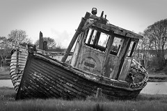 Sail Away (On the mountain at dawn) Tags: boat ship wreck old dilapidated smashed broken rotten windows wooden grounded still life stranded deserted river bank riverbank black white blackwhite 90mm portrait lens moody lonely decay rural
