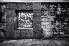 window to the city. (theperplexingparadox) Tags: street travel ireland windows blackandwhite bw dublin canon pavement sidewalk brickwall 1022 dublincastle canonefs1022mmf3545usm canon1022 squarewindow canonefs1022 canon400d