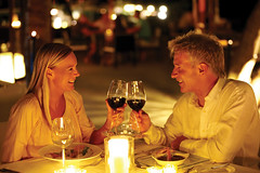 Mature couple enjoying candlelight dinner in a restaurant (floridahomesmag) Tags: light two portrait people food woman holiday man male love senior beautiful smiling female dinner table denmark happy person restaurant hotel glasses cafe holding couple sitting candle looking wine eating anniversary drinking handsome lifestyle happiness valentine celebration relationship mature together meal cheers romantic dining candlelight aged middle success luxury enjoying toasting