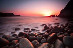 Rounded Glow (Olly Plumstead) Tags: ocean pink light sunset sea orange 6 seascape blur misty wales composition canon landscape golden evening rocks long exposure mark circles low tripod wave pebbles iso boulders ii round 5d olly 50 rounded pembrokeshire seconds plumstead 5d2