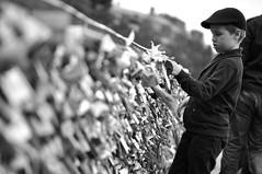 Un jour... (Ambroise .D) Tags: bridge bw paris art kid cadenas noir streetphotography nb cap pont casquette enfant padlock blanc doisneau archevch