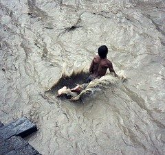 Bagmati River Jump ( Jamie Mitchell) Tags: travel nepal orange man men water smile swimming river temple pagoda jumping asia hand religion culture holy kathmandu om shiva hindu hinduism lingam mandir sadhu pashupatinath bagmati
