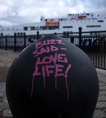 Buzz Said - Love Life (frisiabonn) Tags: life love purple writing moor dock stena mersey river ship sea mooring quay metal buzz quote merseyside birkenhead moored spraypaint paint spray uk great britain england united kingdom maritime