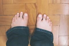 details (luluferrari) Tags: people body film 35mm olympus om10 kodak kodakultramax400 human feet lookingdown foot