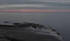 fboda, sunglow and salty rocks (Mika Lehtinen) Tags: fbodasept dark water darkwater sea shore strand klippor kvll ilta fboda jakobstad pietarsaari